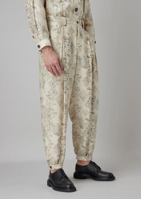 Oversized trousers in printed crumple-effect twill with pleats