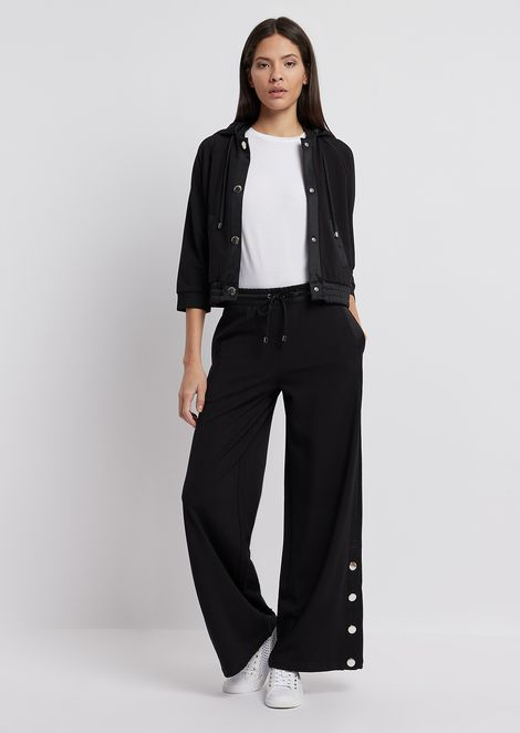 Palazzo trousers with buttons at the hem