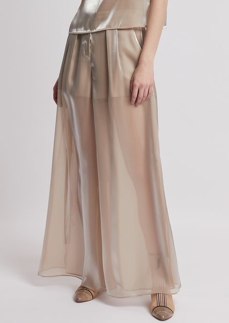 Palazzo trousers in liquid organza with laces at the hem