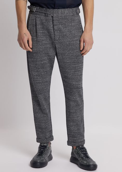 Trousers in micro-houndstooth jacquard fabric with straps