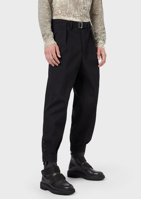 Stretch gabardine trousers with darts and a strap at the waist