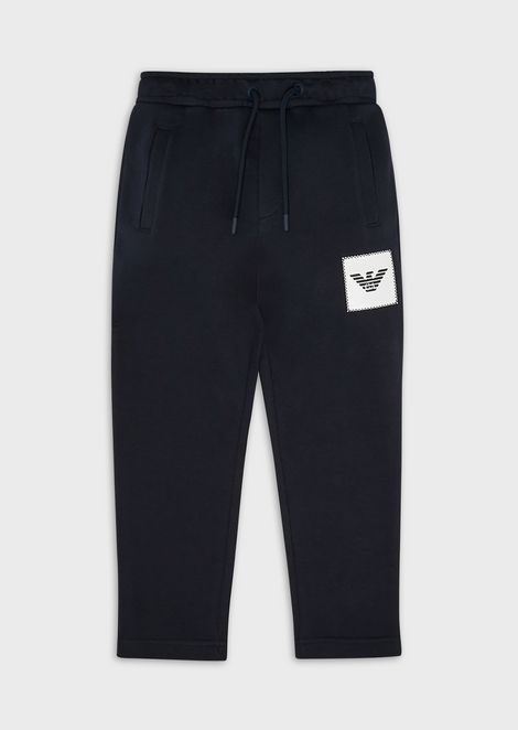 Jogging trousers with logo patch