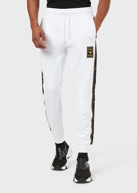 Jogging trousers with logoed patch and side stripes