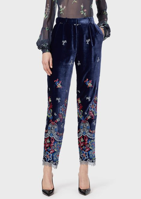 Floral embroidered velvet trousers with fringes at the hem