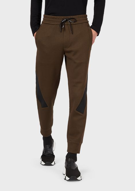 Jogging trousers with contrasting stripes and logo
