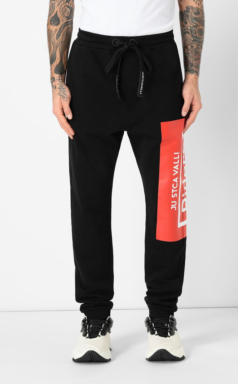 JUST CAVALLI Track pants with print design Casual pants Man r