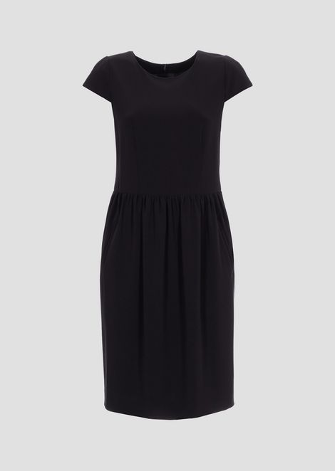 Dress in light wool with gathered waistline