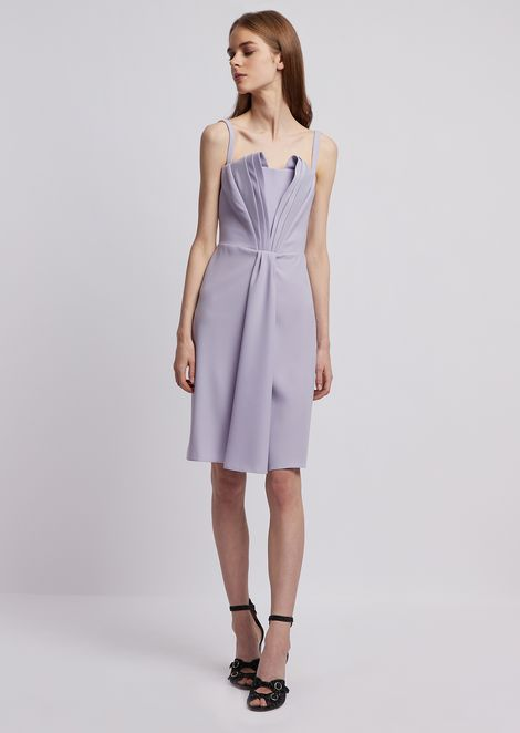 Dress with stiff lined bodice and pleats