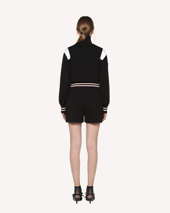 REDValentino Jersey jumpsuit with embroidered space patches