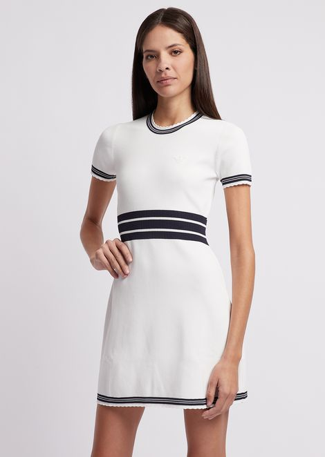 Flared dress in stitched fabric with contrast details