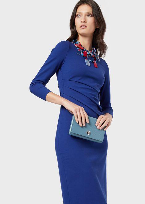 Milano stitch jersey dress with slanting pleats at the waistline