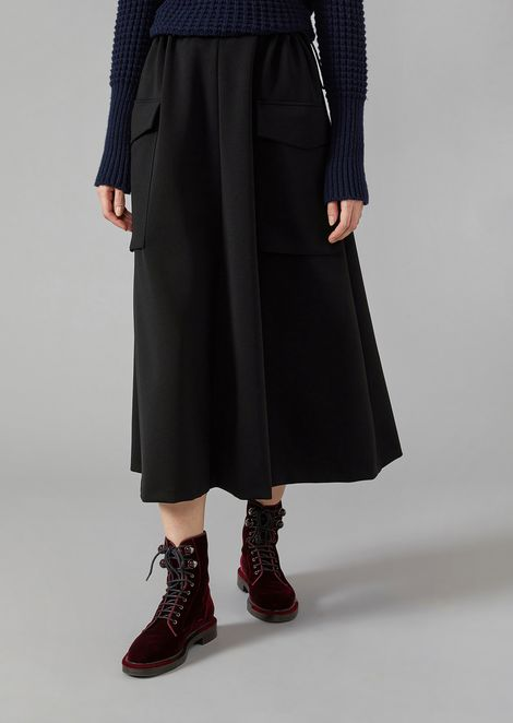 Mid-length skirt in technical jersey with maxi pockets