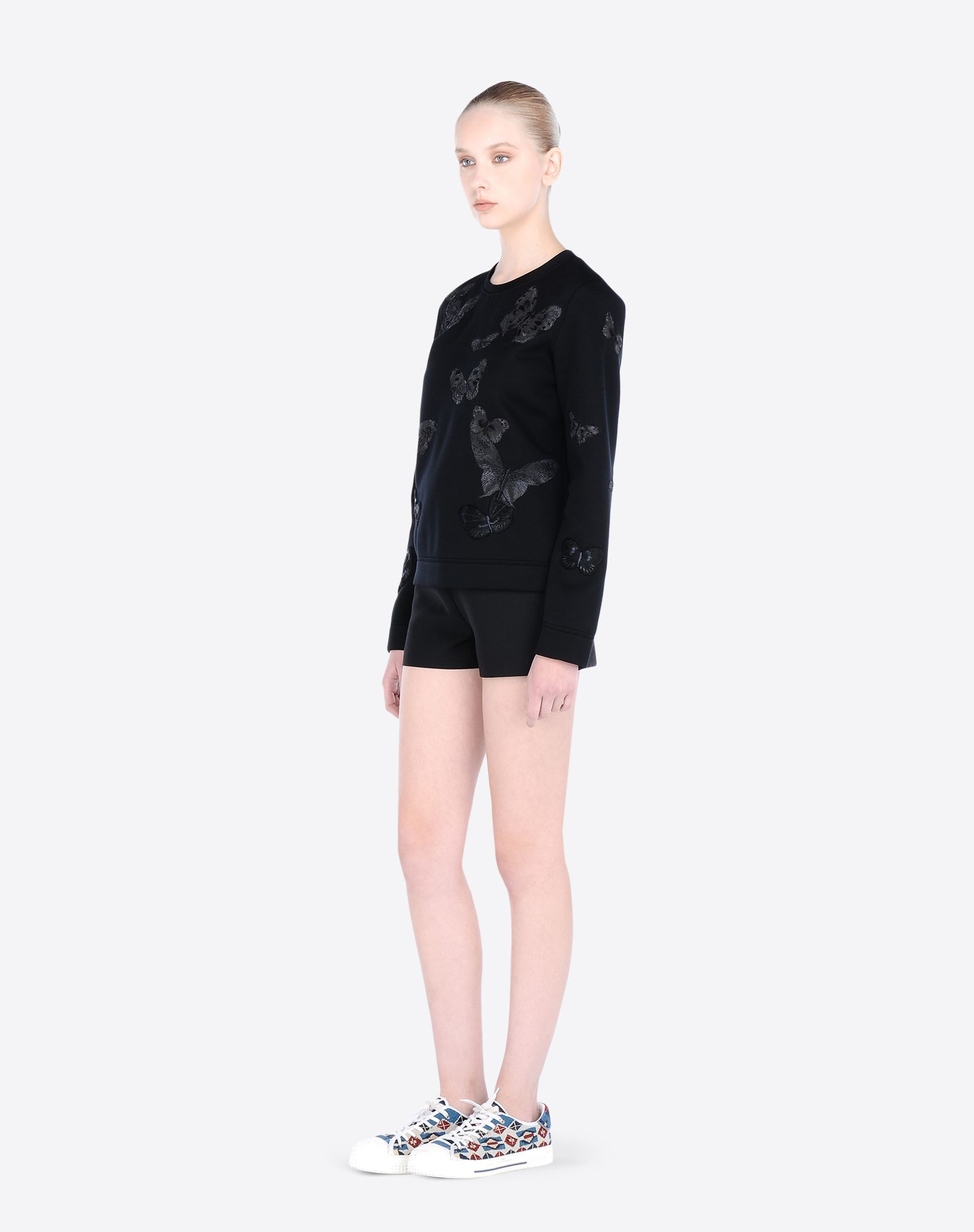 VALENTINO Shorts in solid crepe couture.  - Concealed side fastening.  - Length 33 cm.  - Silk lining.  - Crepe Couture (65% Virgin Wool, 35% Silk).  - Regular fit.  The model is 176 cm tall and wears an Italian size 40.  - Made in Italy.    36767911wd