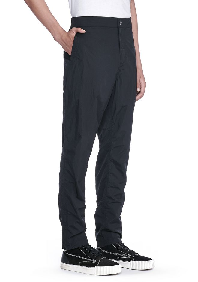 T by ALEXANDER WANG PANTS Men WASHED NYLON TRACK PANTS