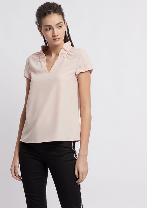 Poly crepe short-sleeved top with rouches on the collar.