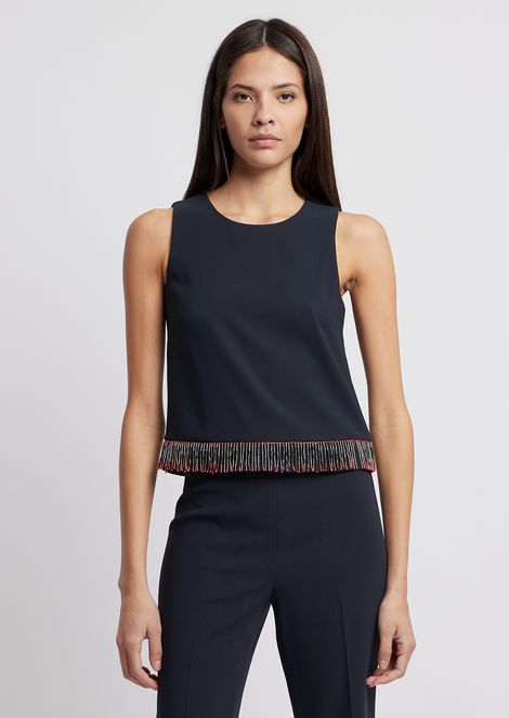 Top in techno crêpe cady with sequins at the hem