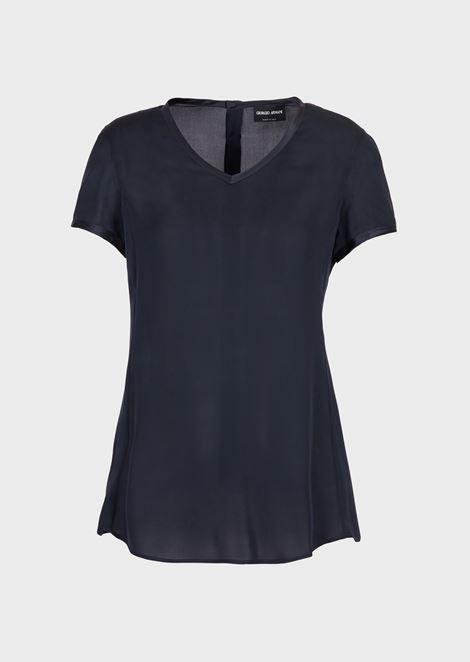 Blusa de charmés de seda con cuello de pico