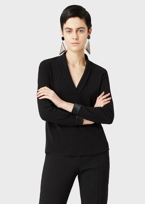 A viscose interlock V-neck blouse with matching satin cuffs