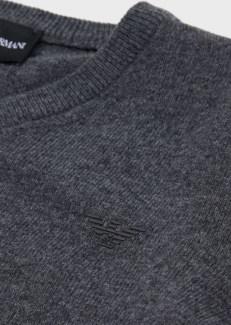 Cotton blend plain knit jumper with V-neck and logo on the front
