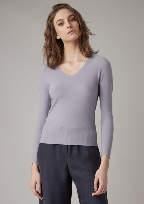 Moss-stitch sweater with plain-knit fabric on the sleeves