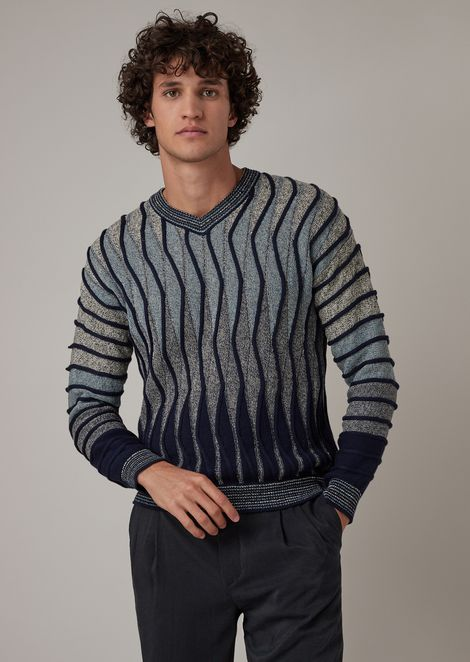 Plain and purl knit sweater with undulating ripples