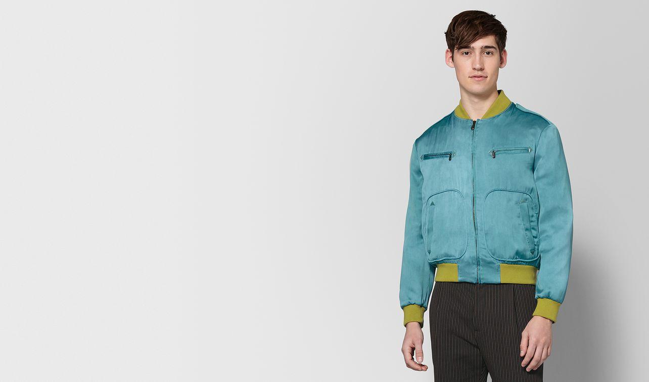 light aqua silk jacket landing