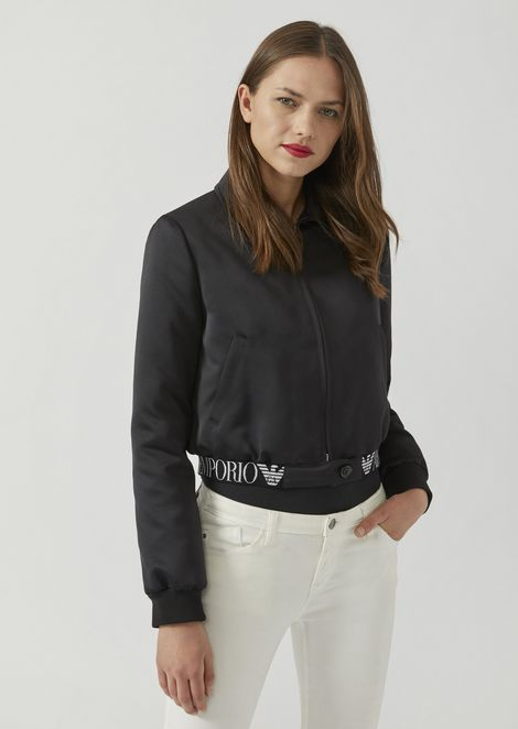 Bomber in technical fabric with elasticated logo band