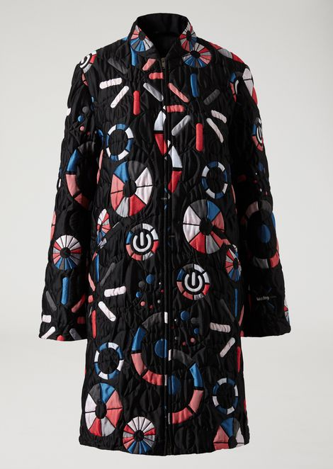 Coat in quilted jacquard fabric with loading motif