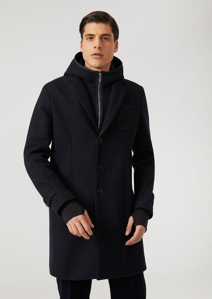 Manteau en drap technique à capuche, plastron zippé et