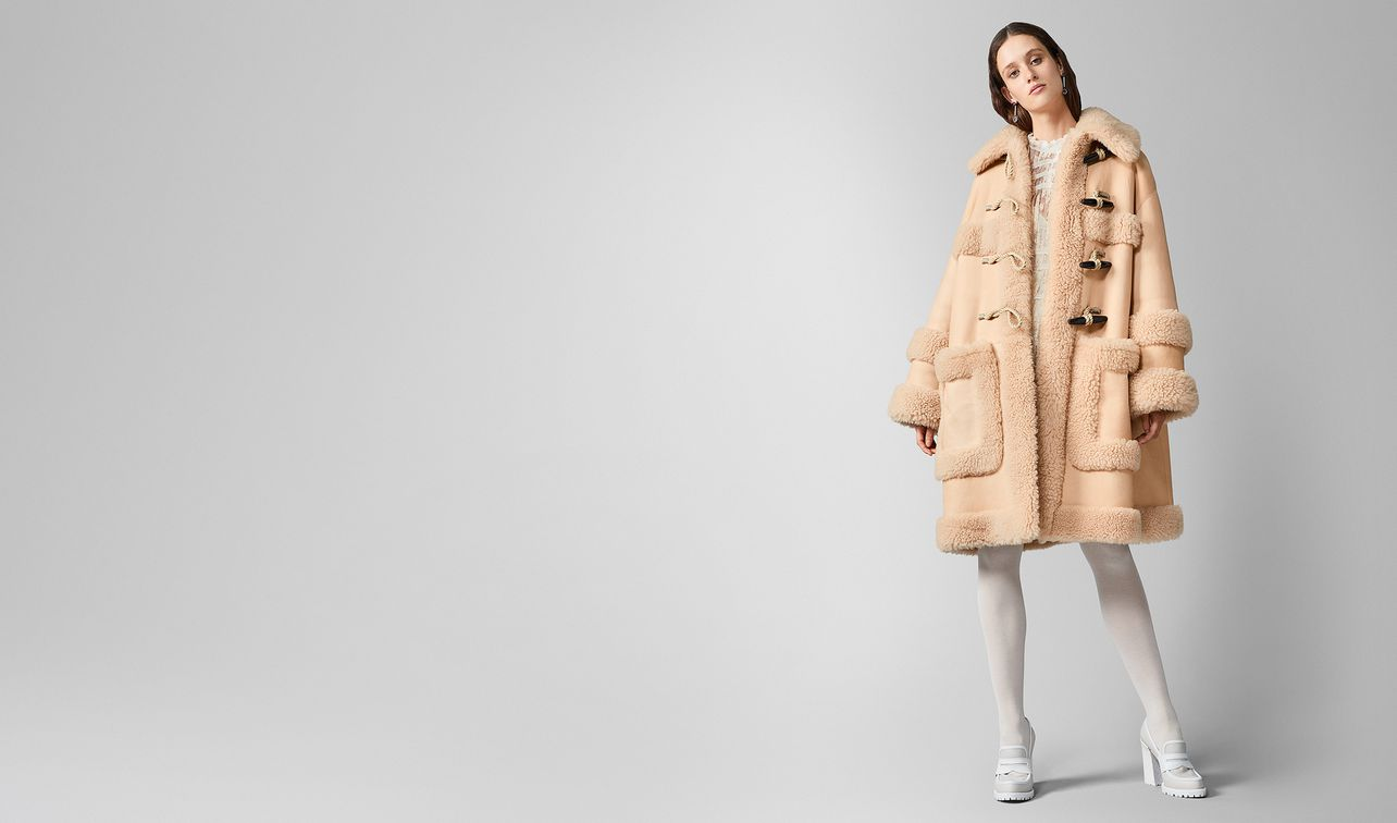 coat in shearling  landing