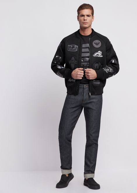 Bomber in poly mesh with appliqued graphic patches