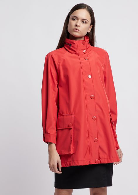 Polyester raincoat with hood and drawstring on the back