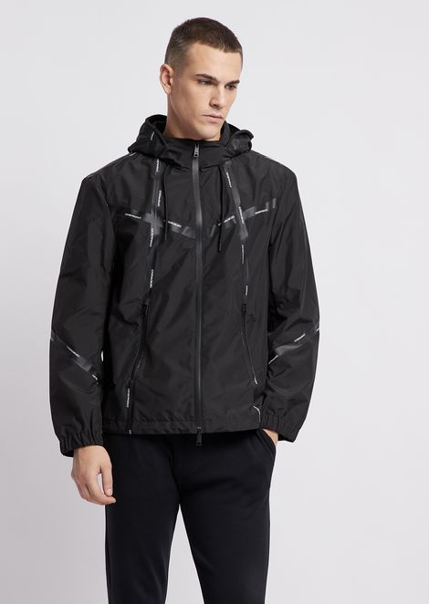 Nylon wind jacket with heat-sealed logo taping