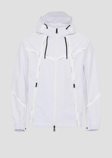 Nylon wind jacket with heat-sealed logo taping