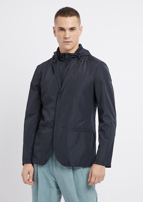 Jacket in tech fabric with hood and drawstring