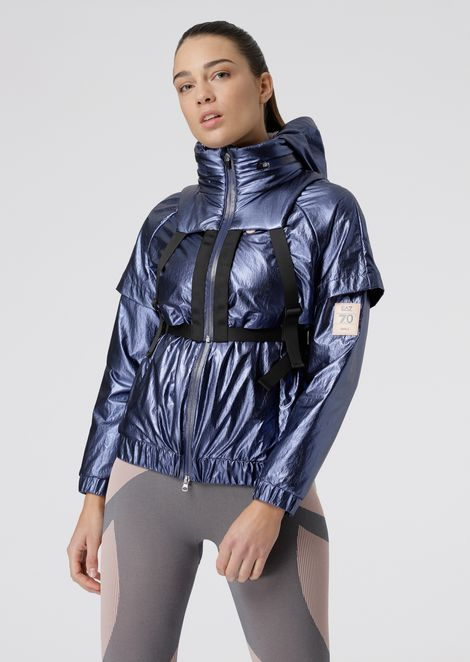 Metallic fabric windbreaker with incorporated removable backpack