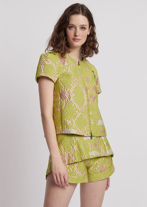 Short-sleeved blouson in snake-motif jacquard fabric
