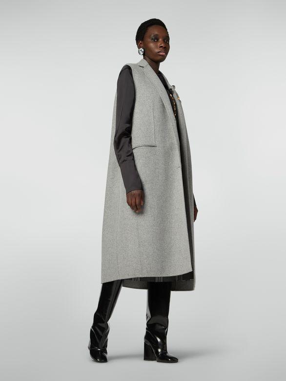 Manteau long ceinture femme