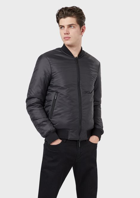 Reversible bomber with quilted logo