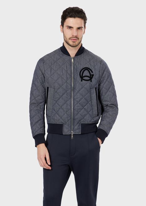 Bomber in raw quilted denim with a GA logo