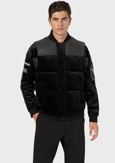 Sleeveless down jacket in quilted velvet