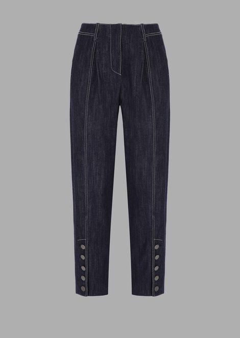Stretch denim buttoned trousers at hem