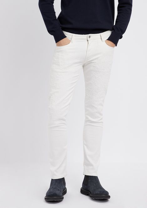 Slim-fit jeans in stretch cotton denim with distressed effect