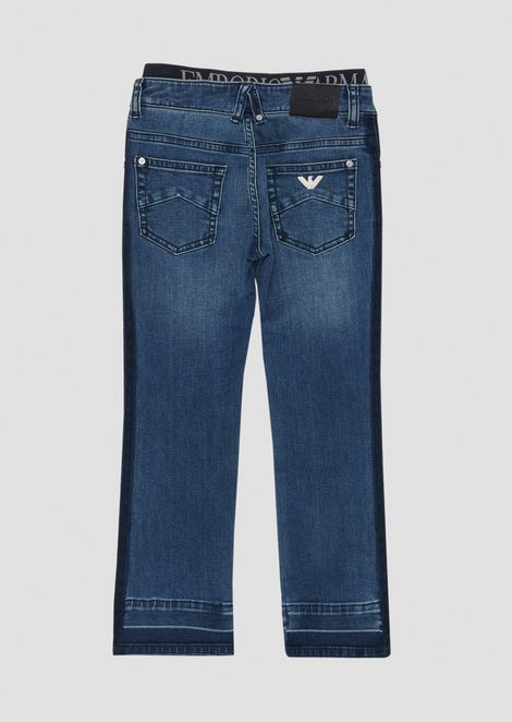 Jeans in denim di cotone stretch con elastico logato in vita