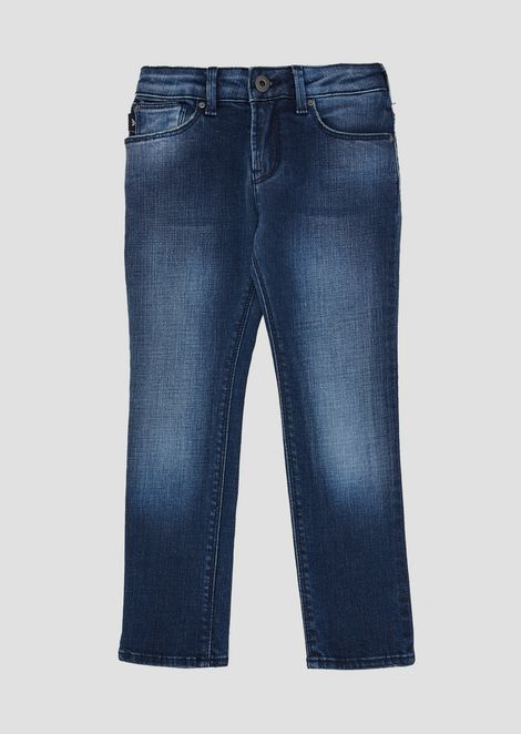 Stone-washed, stretch cotton denim jeans