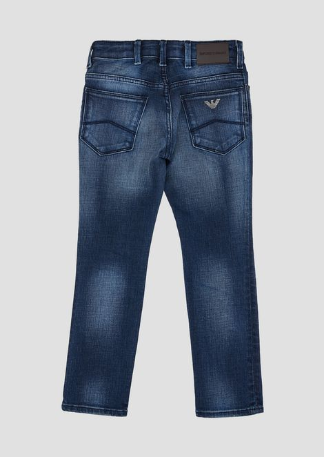 Stone-washed, stretch cotton denim jeans