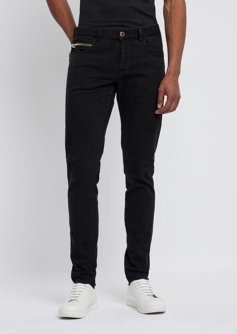 J09 vintage denim jeans with red label and golden details
