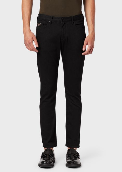 Slim-fit J06 jeans in comfort twill and eagle with studs