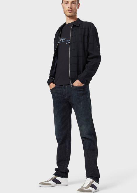 Regular-fit, 11 oz. garment-washed denim jeans with a soft handle