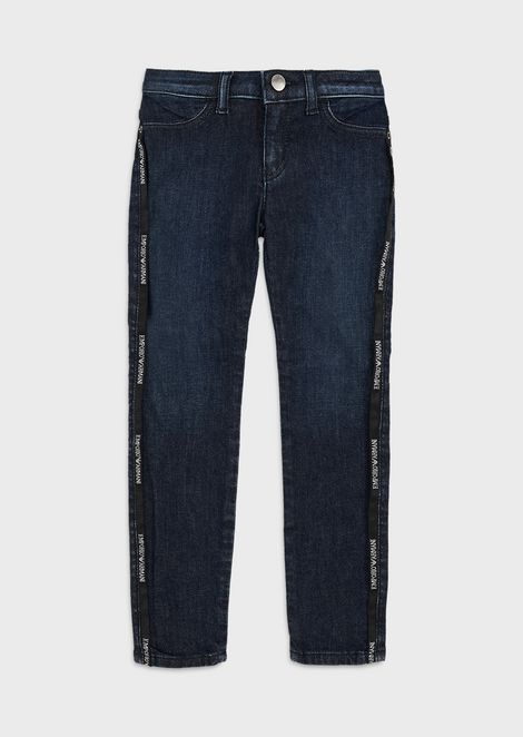Denim jeans with logo piping